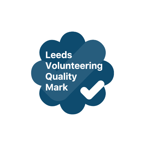 Navy floret with the words Leeds Volunteering Quality Mark inside with a white tick